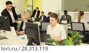 Купить «Business people working in coworking space», фото № 28313119, снято 10 марта 2018 г. (c) Яков Филимонов / Фотобанк Лори
