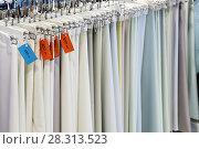 Купить «Fabric for sewing traditional Arabic clothing for men.», фото № 28313523, снято 9 апреля 2018 г. (c) Володина Ольга / Фотобанк Лори