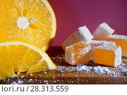 Купить «Апельсиновый рахат лукум и большой апельсин, Восточные сладости», фото № 28313559, снято 18 апреля 2018 г. (c) ирина реброва / Фотобанк Лори