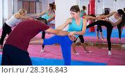Купить «Women doing kick with coach», фото № 28316843, снято 8 октября 2017 г. (c) Яков Филимонов / Фотобанк Лори