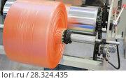 Купить «Polymer plastic bags manufactured roll», видеоролик № 28324435, снято 12 апреля 2018 г. (c) Андрей Радченко / Фотобанк Лори