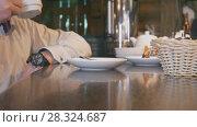 Купить «Man in caffee drinks coffee or tea», видеоролик № 28324687, снято 23 июля 2019 г. (c) Константин Шишкин / Фотобанк Лори