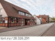 Купить «Street with shops in a German town in the early spring morning», фото № 28326291, снято 11 мая 2013 г. (c) Юлия Бабкина / Фотобанк Лори