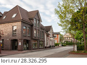 Купить «Street with beautiful two-story houses in German town in early spring morning», фото № 28326295, снято 11 мая 2013 г. (c) Юлия Бабкина / Фотобанк Лори
