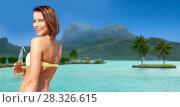 Купить «woman in bikini with drink on bora bora beach», фото № 28326615, снято 11 июля 2013 г. (c) Syda Productions / Фотобанк Лори