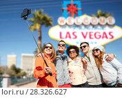 Купить «friends travelling to las vegas and taking selfie», фото № 28326627, снято 19 марта 2015 г. (c) Syda Productions / Фотобанк Лори