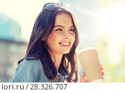 Купить «happy young woman drinking coffee on city street», фото № 28326707, снято 12 мая 2016 г. (c) Syda Productions / Фотобанк Лори
