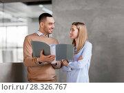 Купить «man and woman with folders at office stairs», фото № 28326767, снято 25 февраля 2018 г. (c) Syda Productions / Фотобанк Лори