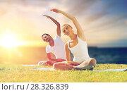 Купить «couple making yoga exercises outdoors», фото № 28326839, снято 6 августа 2014 г. (c) Syda Productions / Фотобанк Лори