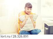 Купить «asian young woman watching tv at home», фото № 28326891, снято 9 марта 2016 г. (c) Syda Productions / Фотобанк Лори