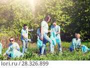 Купить «volunteers with garbage bags cleaning park area», фото № 28326899, снято 7 мая 2016 г. (c) Syda Productions / Фотобанк Лори