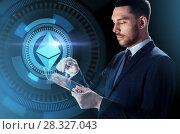 Купить «businessman with tablet pc and ethereum hologram», фото № 28327043, снято 9 марта 2017 г. (c) Syda Productions / Фотобанк Лори