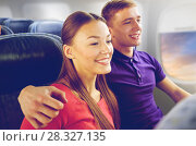 Купить «happy couple travelling by plane», фото № 28327135, снято 21 октября 2015 г. (c) Syda Productions / Фотобанк Лори