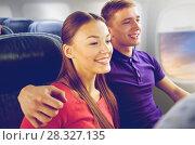 Купить «happy couple travelling by plane», фото № 28327135, снято 21 октября 2015 г. (c) Syda Productions / Фотобанк Лори