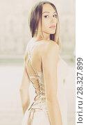 Купить «close-up portrait of young female with long hair in romantic ivory midi gown», фото № 28327899, снято 24 июня 2017 г. (c) Яков Филимонов / Фотобанк Лори
