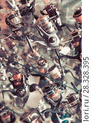 Купить «Image of stand with new baitcasting reel for rod», фото № 28328395, снято 16 января 2018 г. (c) Яков Филимонов / Фотобанк Лори