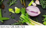 Купить «close up of green vegetables on stone table», видеоролик № 28328723, снято 14 апреля 2018 г. (c) Syda Productions / Фотобанк Лори