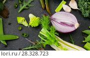 Купить «close up of green vegetables on stone table», видеоролик № 28328723, снято 14 апреля 2018 г. (c) Syda Productions / Фотобанк Лори