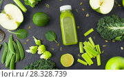 Купить «bottle with green juice and vegetables on table», видеоролик № 28328739, снято 14 апреля 2018 г. (c) Syda Productions / Фотобанк Лори
