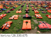 Купить «A group of charities, including the International Rescue Committee and the UNHCR display hundreds of lifejackets on Parliament Square that were once worn...», фото № 28330675, снято 19 сентября 2016 г. (c) age Fotostock / Фотобанк Лори