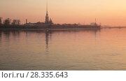 Купить «Peter and Paul Fortress at dawn, St. Petersburg, Russia», видеоролик № 28335643, снято 15 апреля 2018 г. (c) Юлия Бабкина / Фотобанк Лори