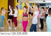 Купить «Children dancing rock-and-roll in pairs in choreography class wi», фото № 28335895, снято 3 марта 2018 г. (c) Яков Филимонов / Фотобанк Лори