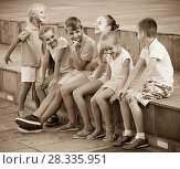 Купить «portrait of children spending time outside and playing charades», фото № 28335951, снято 25 апреля 2018 г. (c) Яков Филимонов / Фотобанк Лори