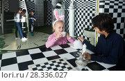 Купить «young players play in chess quest room», фото № 28336027, снято 21 октября 2017 г. (c) Яков Филимонов / Фотобанк Лори