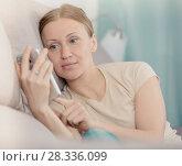 Купить «Upset woman with phone», фото № 28336099, снято 12 апреля 2017 г. (c) Яков Филимонов / Фотобанк Лори