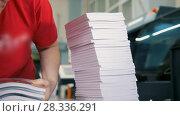 Купить «Hands of female worker folds a paper stacks in typography», видеоролик № 28336291, снято 24 апреля 2018 г. (c) Константин Шишкин / Фотобанк Лори