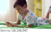Купить «boy with notebook and pencils drawing at home», видеоролик № 28338047, снято 20 апреля 2018 г. (c) Syda Productions / Фотобанк Лори