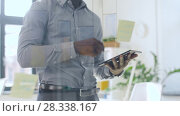 Купить «businessman with tablet pc at office glass wall», видеоролик № 28338167, снято 19 апреля 2018 г. (c) Syda Productions / Фотобанк Лори