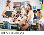 Купить «Students having informal chat with teacher», фото № 28338543, снято 23 марта 2019 г. (c) Яков Филимонов / Фотобанк Лори