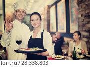 Купить «Smiling waitress with chef in the restaurant», фото № 28338803, снято 11 декабря 2017 г. (c) Яков Филимонов / Фотобанк Лори