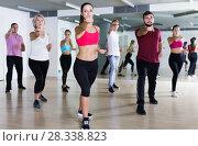 Купить «People training at dance class», фото № 28338823, снято 9 октября 2017 г. (c) Яков Филимонов / Фотобанк Лори