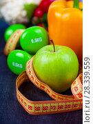 Купить «Food for diet and dumbbells», фото № 28339559, снято 12 апреля 2018 г. (c) Елена Блохина / Фотобанк Лори
