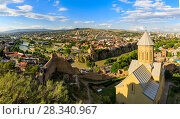 Купить «Panoramic view of Tbilisi city from the Narikala Fortress, old town and modern architecture. Tbilisi the capital of Georgia», фото № 28340967, снято 17 октября 2018 г. (c) Mikhail Starodubov / Фотобанк Лори