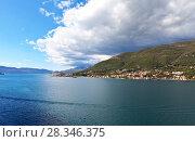 Купить «Montenegro. The coast of Kotor Bay. Beautiful view from the sea to the port and the town of Djenovici», фото № 28346375, снято 8 октября 2016 г. (c) Виктория Катьянова / Фотобанк Лори