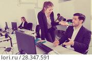Купить «Sexual harassment between two colleagues and flirting in office», фото № 28347591, снято 24 марта 2018 г. (c) Яков Филимонов / Фотобанк Лори