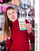 Купить «female is looking on modern accessories for hair», фото № 28347679, снято 22 марта 2018 г. (c) Яков Филимонов / Фотобанк Лори