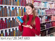 Купить «Happy woman is choosing new hair dye», фото № 28347683, снято 22 марта 2018 г. (c) Яков Филимонов / Фотобанк Лори