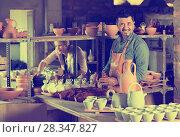 Купить «Smiling workers in ceramics workroom», фото № 28347827, снято 25 мая 2019 г. (c) Яков Филимонов / Фотобанк Лори