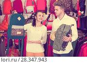Купить «Young loving couple deciding on sports bag», фото № 28347943, снято 22 ноября 2016 г. (c) Яков Филимонов / Фотобанк Лори