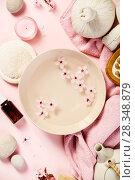 Купить «SPA settings on pink background», фото № 28348879, снято 4 апреля 2018 г. (c) Наталия Кленова / Фотобанк Лори