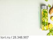 Купить «Infused water in a bottle», фото № 28348907, снято 5 апреля 2018 г. (c) Наталия Кленова / Фотобанк Лори