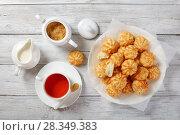Купить «homemade coconut cookies and cup of tea», фото № 28349383, снято 21 апреля 2018 г. (c) Oksana Zh / Фотобанк Лори