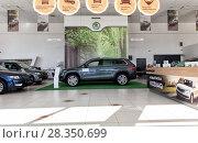 Купить «Selling cars Skoda in the showroom. New products automaker Skoda», фото № 28350699, снято 7 июня 2017 г. (c) Евгений Ткачёв / Фотобанк Лори