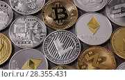 A pattern from different coins of crypto currency on a dark background. Slow motion. 1080p Full HD video. Стоковое видео, видеограф Ярослав Данильченко / Фотобанк Лори