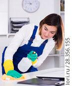 Купить «Female cleaner at work», фото № 28356155, снято 19 июля 2018 г. (c) Яков Филимонов / Фотобанк Лори
