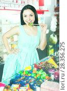 Купить «Woman posing to photographer with lollypop», фото № 28356275, снято 25 апреля 2017 г. (c) Яков Филимонов / Фотобанк Лори